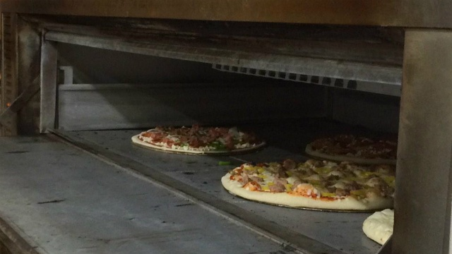 Record dairy prices mean higher pizza prices
