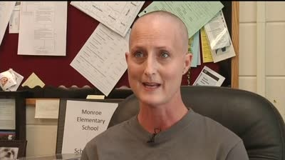 Principal battling cancer surprises students at pep rally