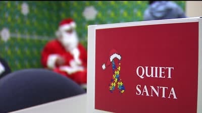"""Quiet Santas"" take wishes from kids with special needs"