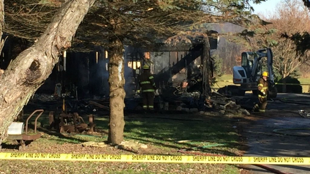 Investigators search for man who'd been staying at scene of fatal house fire