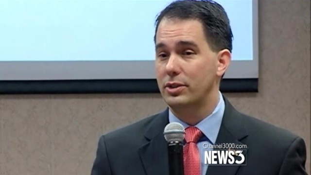 Walker promises more tax cuts in second term