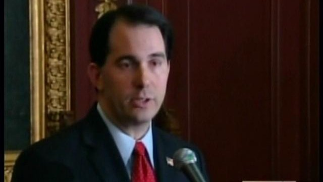 Walker signs early voting bill with partial veto