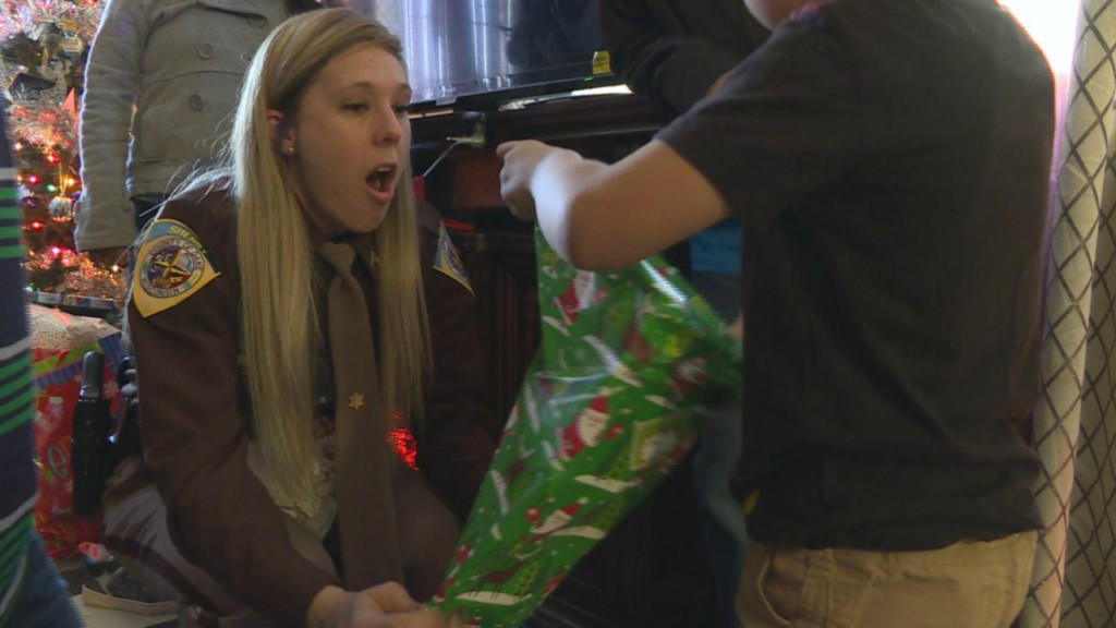 Deputies surprise Fitchburg family with bags of Christmas gifts