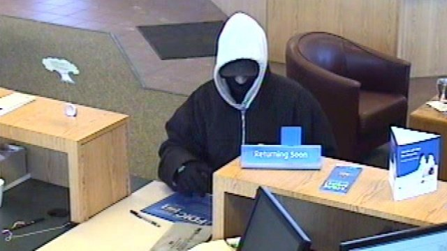 Police release pictures of masked bank robber