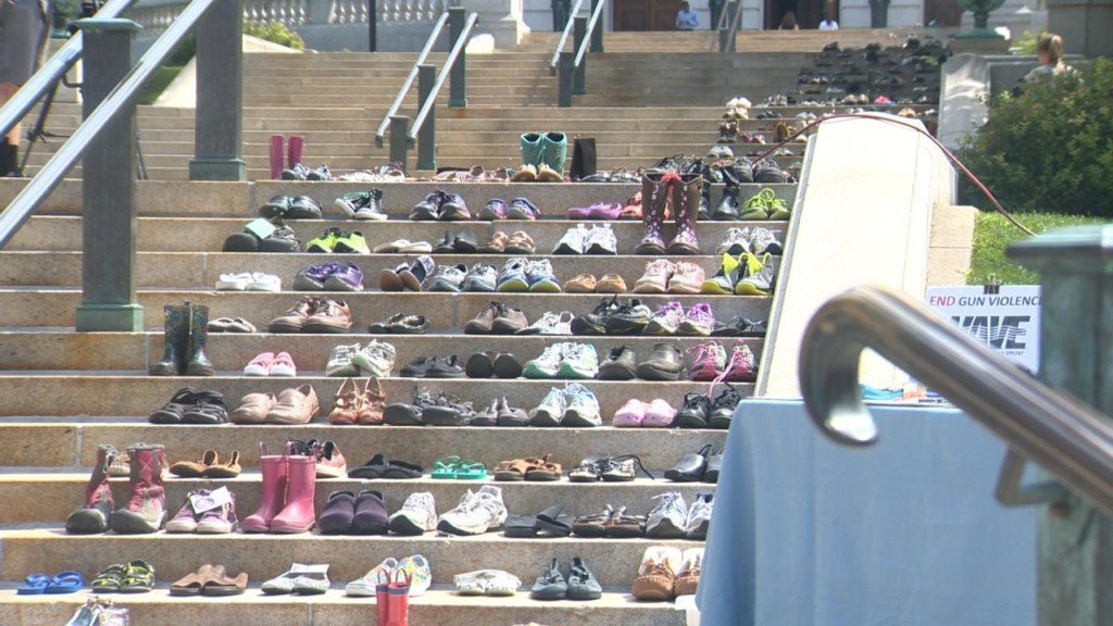 A silent march: 664 pairs of shoes on Capitol steps represent Wisconsinites killed with guns