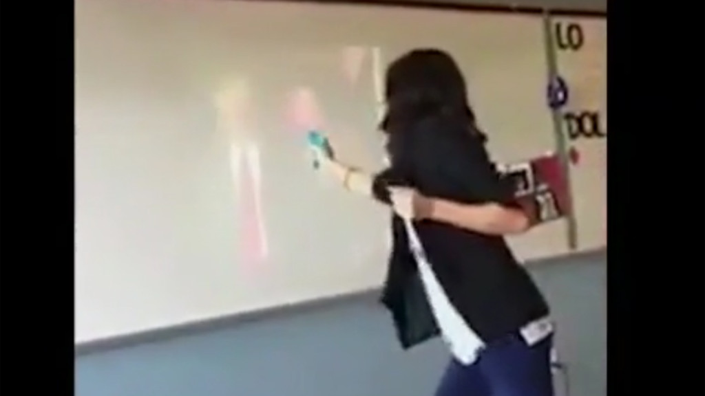 Teacher fires fake gun at Trump image, now on leave
