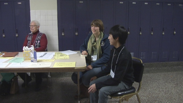 East High School students help at polling locations