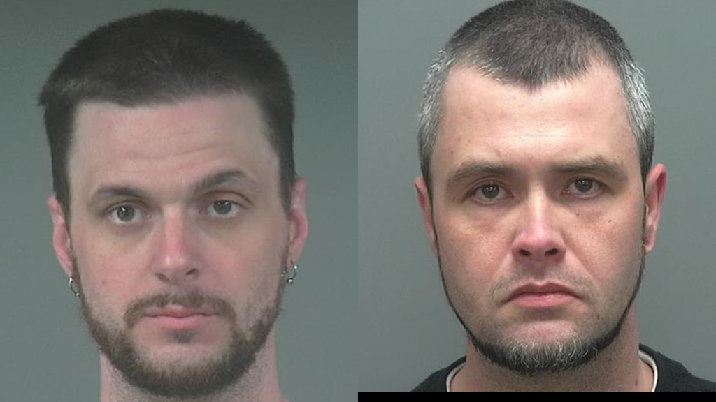 Two men charged with threatening clerks with knife