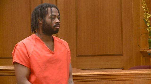 Man accused of stealing car with man in trunk headed to trial