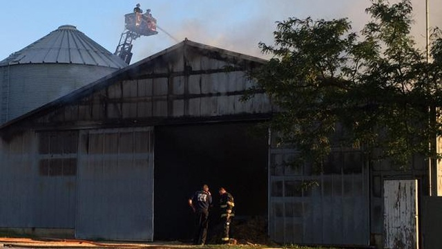 Wet hay might have started barn fire