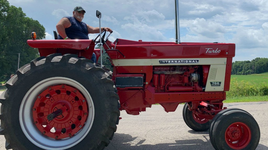Utica antique tractor ride fundraiser gives back to toddler hit by baseball