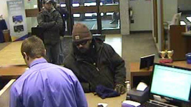 Robber demands money in note at east side bank