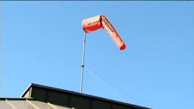 Coffee shop owner fights for windsock