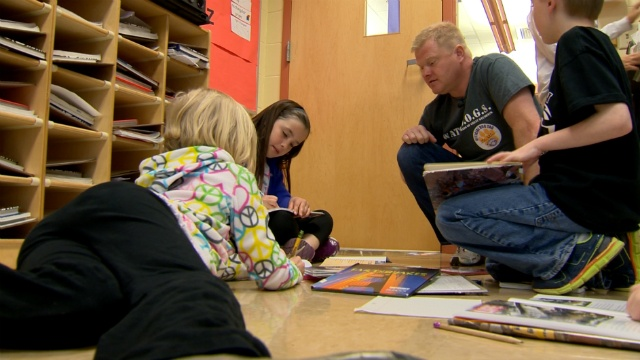 Dads on patrol provide positive example in classrooms