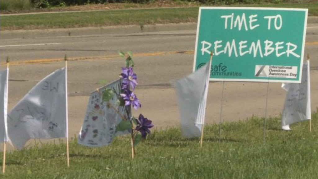 White flag display along Atwood Avenue brings awareness to fatal overdoses