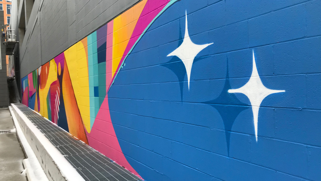 City partners with local artists to bring color to parking garage