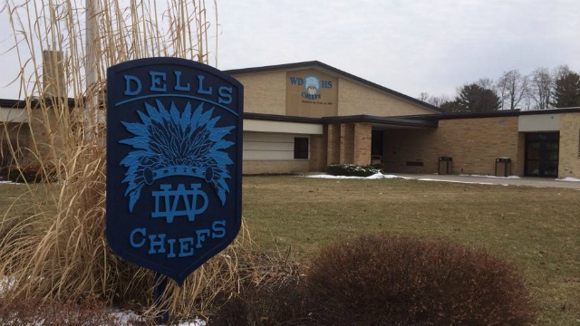 Threat prompts school to hold students in classrooms