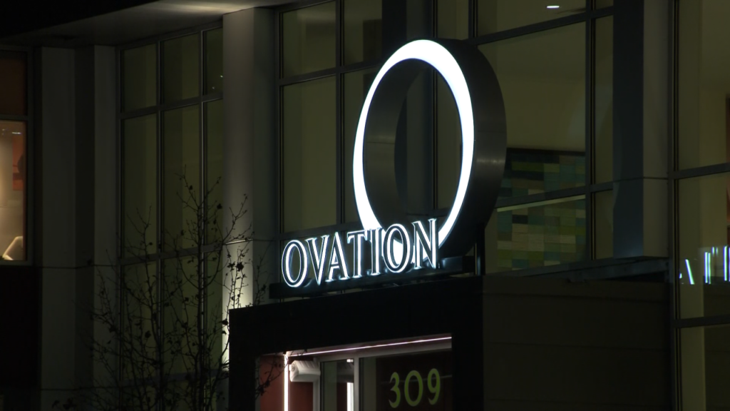 Ovation Apartment Building sign