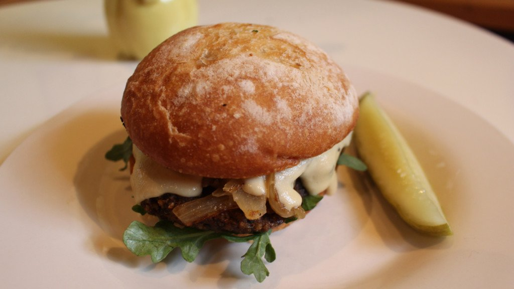 "Green Owl's new house burger with pickled jalapenos and cashew ""cheese"" sauce"
