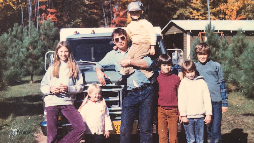 dad with seven kids at a farm