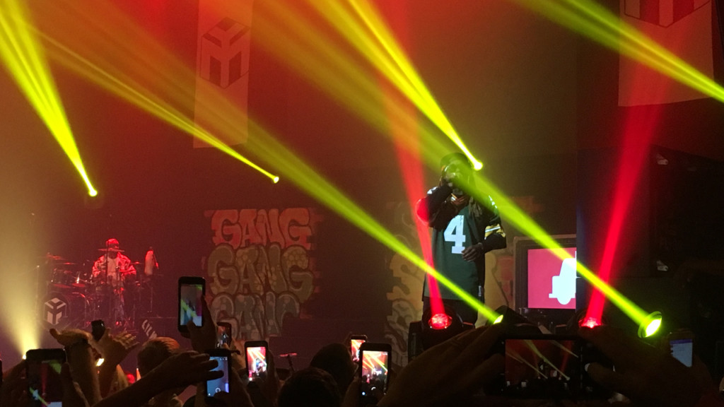 Rapper Lil Wayne performs at the Orpheum Theater in Madison while wearing a Brett Favre jersey