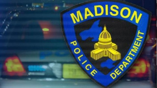 Madison Police Department logo with cop car in background