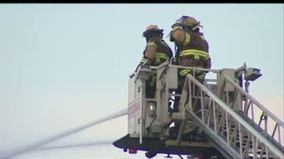 Crews battle fire in downtown Portage