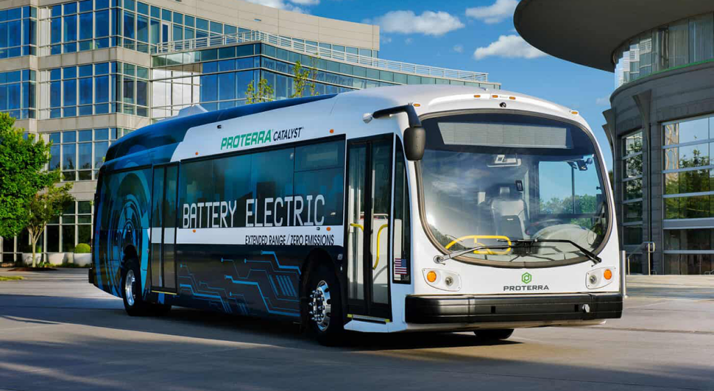 A blue and white 40-foot long Proterra bus.