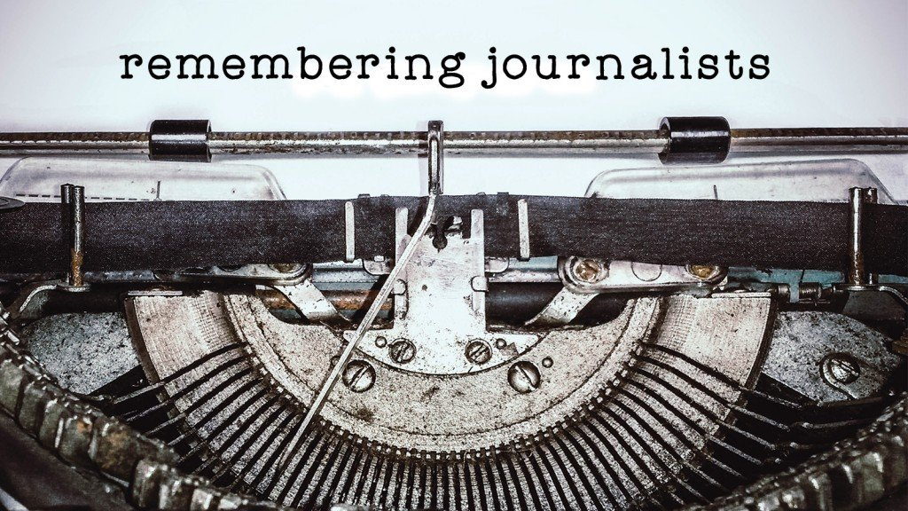 typewriter with remembering journalists above it