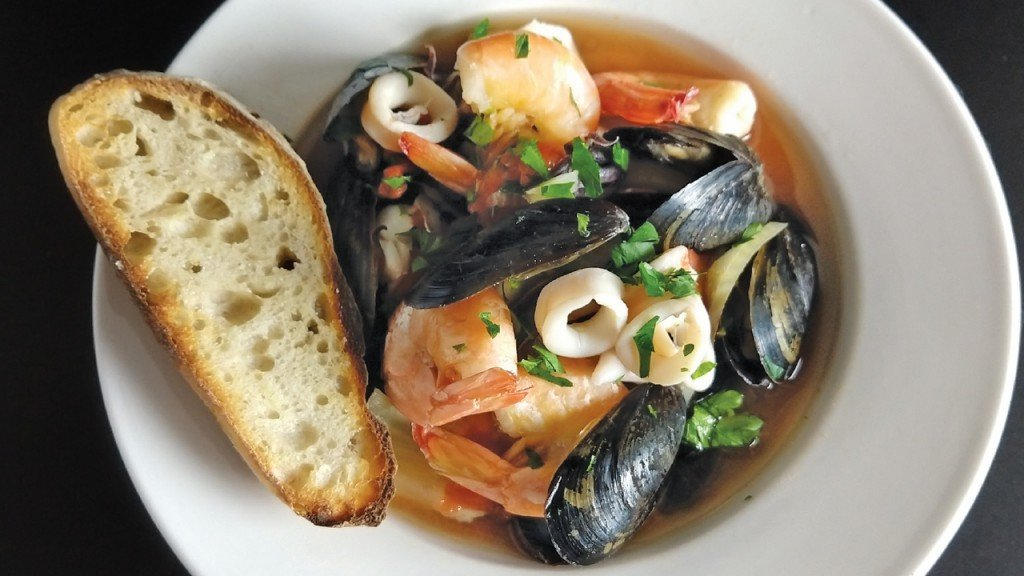 Campo Di Bella dish with seafood, broth and bread