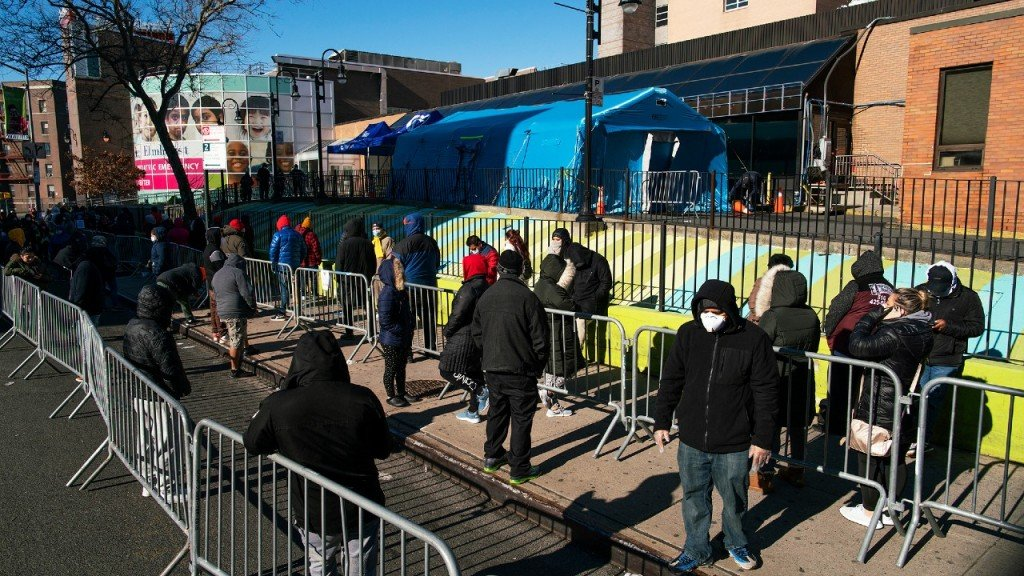 People line up outside Elmhurst Hospital to get tested for the coronavirus in NYC