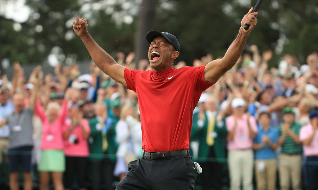 Tiger Woods with a crowd behind him