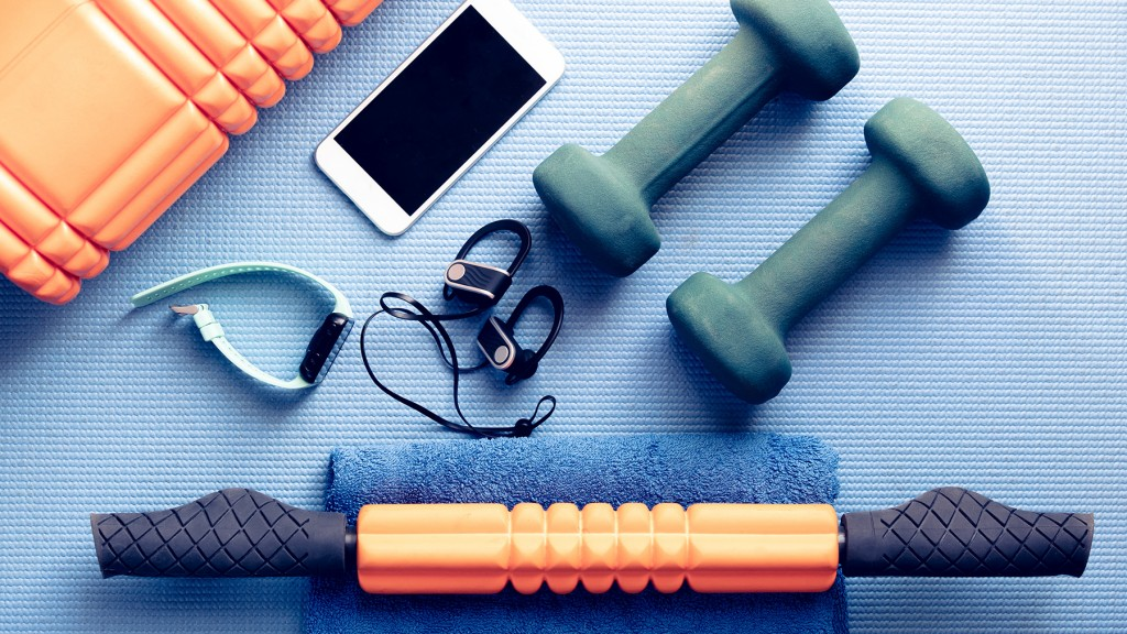 Fitness Equipment And Electronics On A Blue Yoga Mat