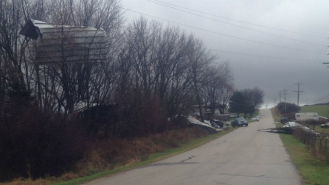 Morning storm blows shed into power line