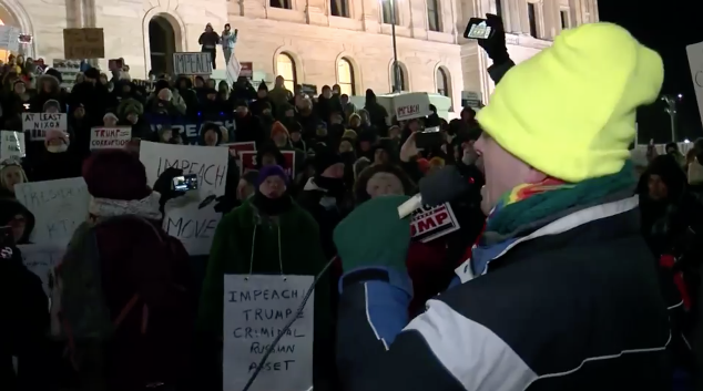 Protesters sing Christmas songs at pro-impeachment rally