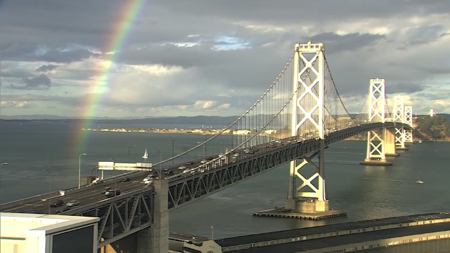 San Francisco bridge glows with rainbow