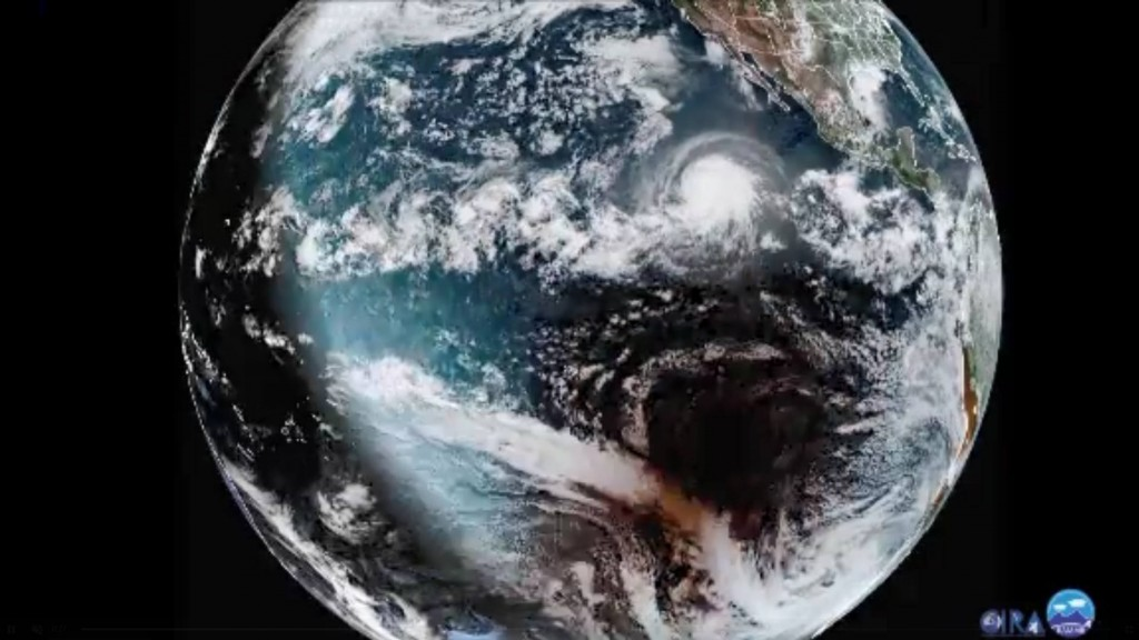 Satellite captures powerful hurricane and solar eclipse at same time
