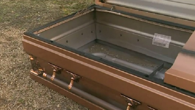 PHOTOS: Empty coffin found on highway in Adams County