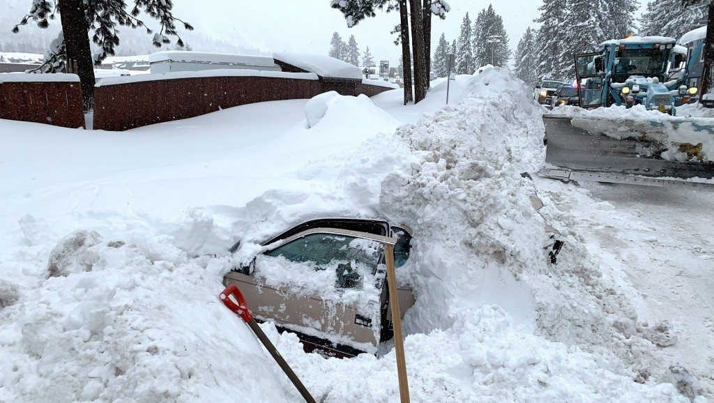 California snowplow driver finds woman alive inside car buried in snow