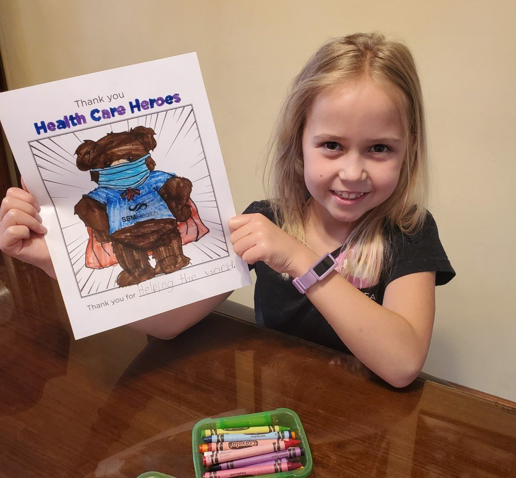 Girl with colored picture to thank healthcare heroes at SSM Health
