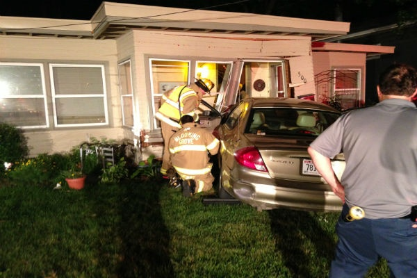 Driver crashes into east side home