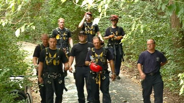 Woman rescued after fall from bluff
