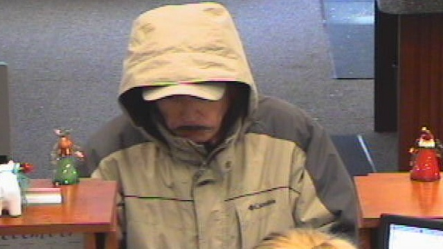 Police look for bank robber with possibly fake mustache
