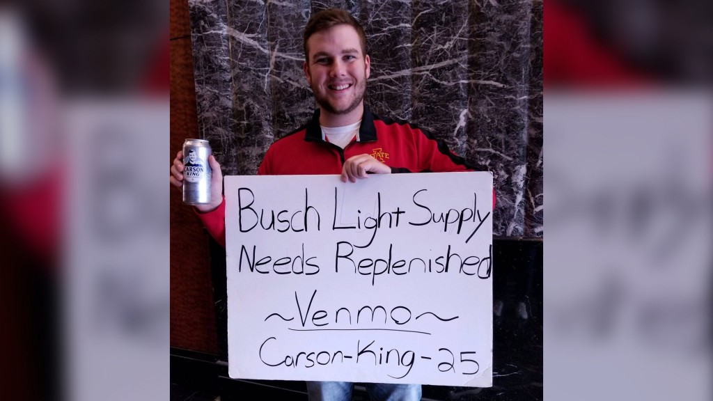 College football fan's sign asking for beer money raises more than $1M