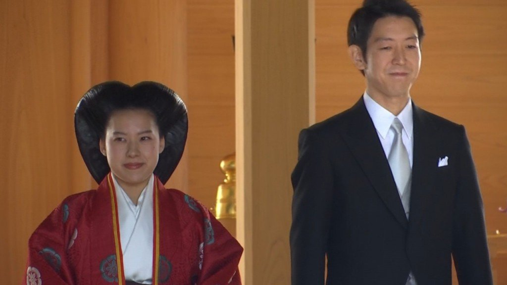 Japan's Princess Ayako surrenders royal status as she marries for love