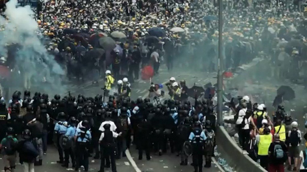 Police fire tear gas at pockets of protesters across Hong Kong