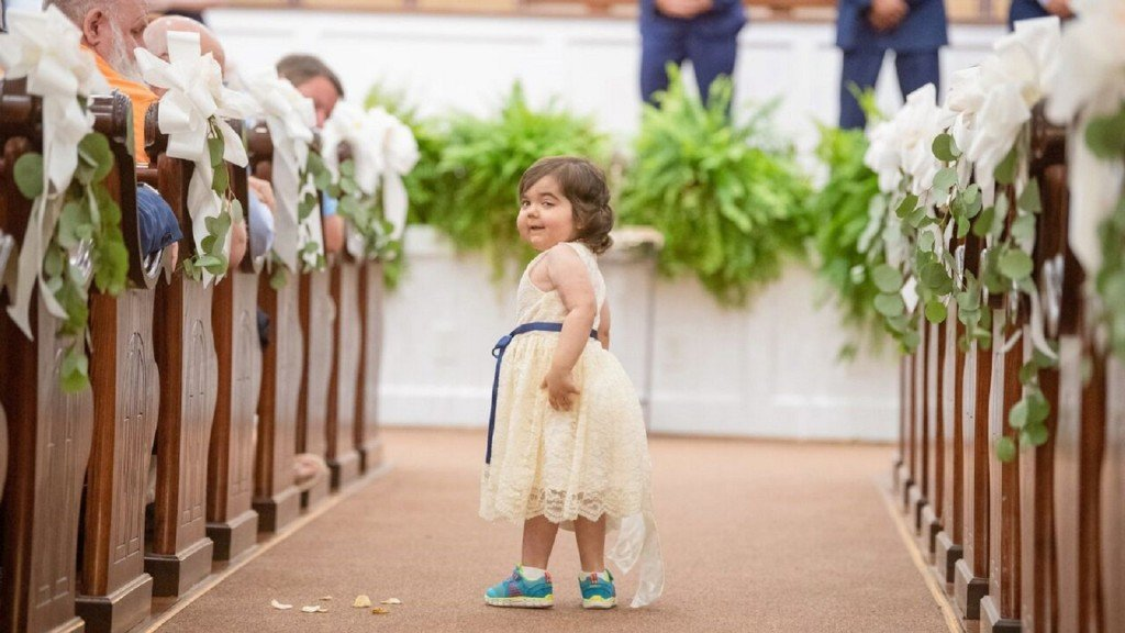 Cancer survivor serves as flower girl