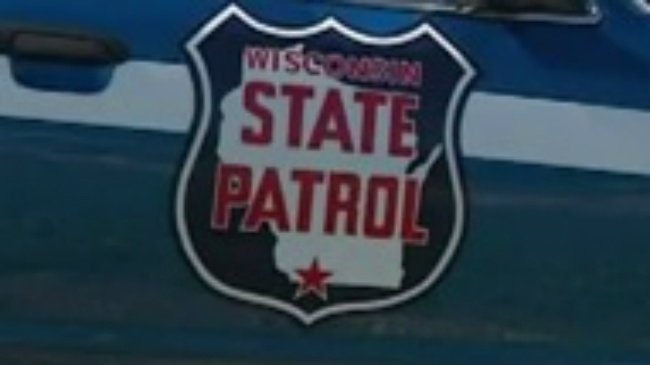 Wisconsin State Patrol logo on side of car door
