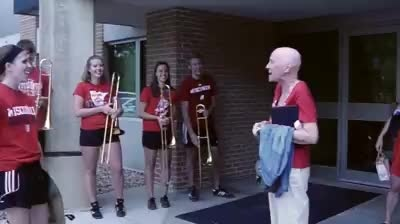 UW Band escorts woman out of last chemo treatment