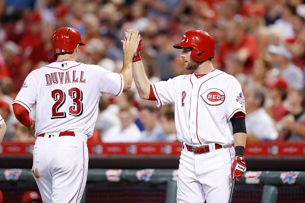 Reds use the long ball to beat Braves
